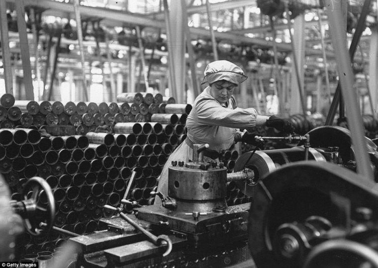 """Female worker in a munitions factory, c1914-1918. Women working in muntions factories were exposed to many dangerous chemicals, which sometimes turned their skin yellow, giving them the colloquial name """"canaries"""". Image courtesy the Daily Mail."""