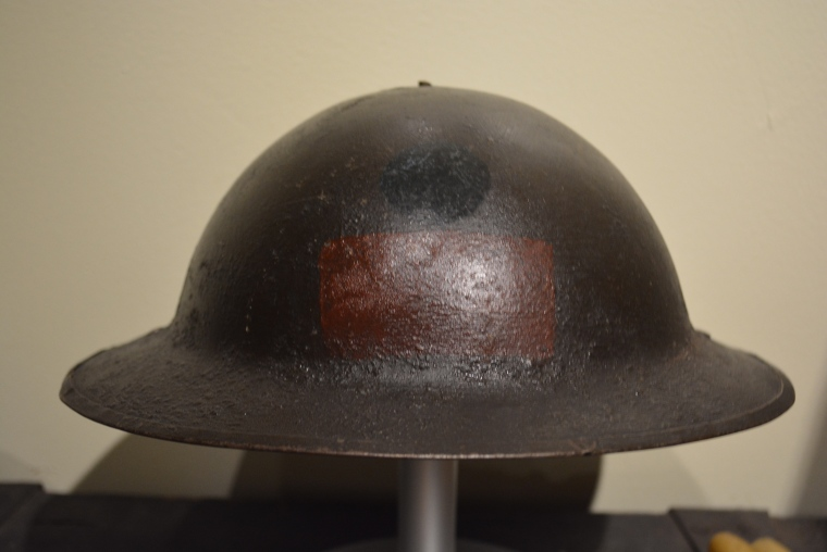 Mk 1 helmet [c1918] with divisional patch of the 1st Battalion, CEF. Collections, CCGW/CCGG