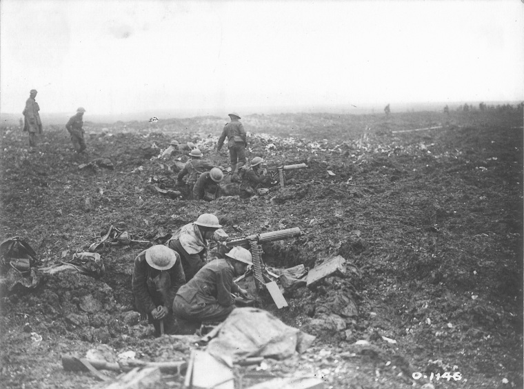 """Battle of Vimy Ridge 1917. Canadian machine gunners fire on retreating Germans"" [""Canadian machine gunners dig themselves in, in shell holes on Vimy Ridge."" Official title.] Alfred Soden English Fonds, Collections CCGW/CCGG"