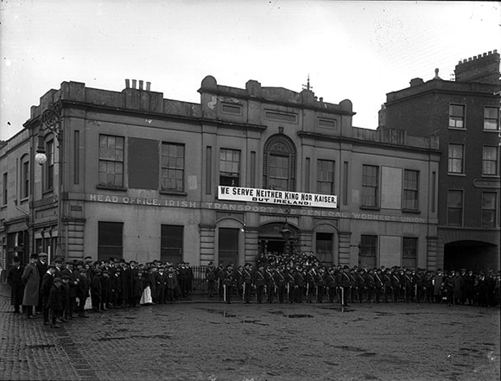 """Members of the Irish Citizen Army outside Liberty Hall, under the slogan """"We serve neither King nor Kaiser, but Ireland"""", National Library of Ireland, KE 198."""