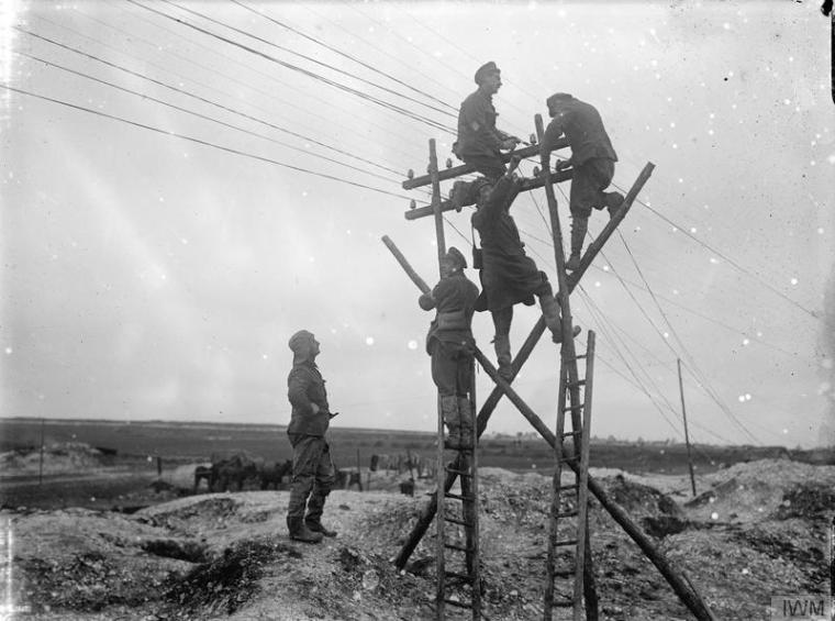Repairing telephone wires in the Ancre Area, Hamel, October 1916. Copyright IWM (Q 1589)