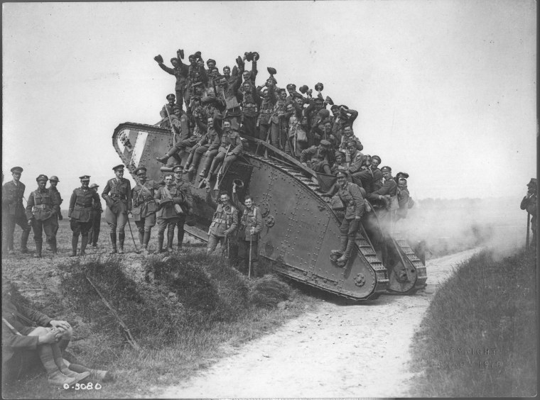 The 5th CMR returning on a tank. Amiens. August 1918. Seeton Collection. CCGW/CCGG 2015.10.13.01